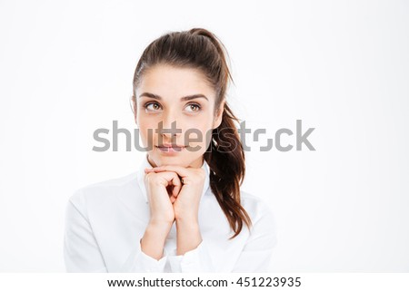 Thinking business woman smiling and looking up at copy space over white background - stock photo