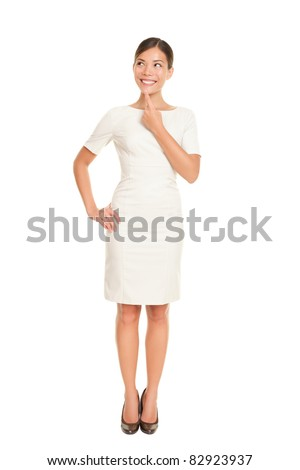 Thinking business woman standing in full body isolated on white background contemplating looking up to the side smiling happy. Beautiful Asian / Caucasian businessowman in dress suit. - stock photo