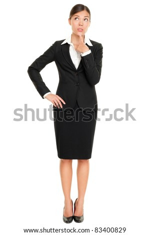 Thinking business woman standing pensive contemplating looking up for inspiration. Beautiful multi-racial Caucasian / Asian businesswoman isolated on white background in full body. - stock photo