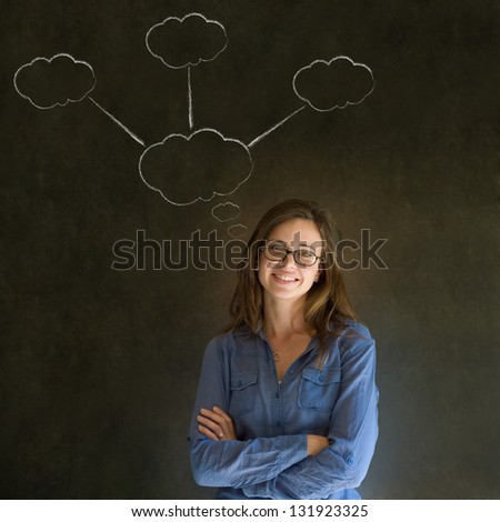 Thinking business woman with chalk cloud thoughts on blackboard background
