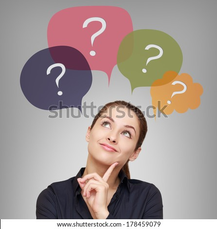 Thinking business woman with many questions in bubbles above - stock photo