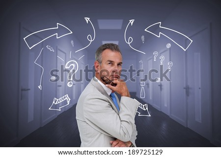 Thinking businessman against bright hallway with several doors - stock photo