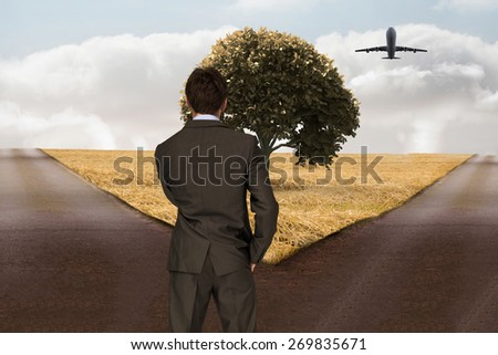 Thinking businessman against crossroads - stock photo
