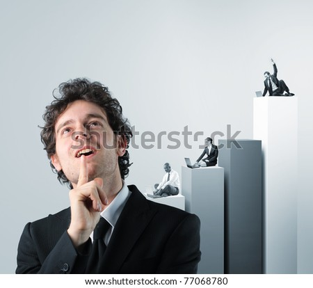 thinking businessman and businesspeople work with laptop on 3d chart - stock photo