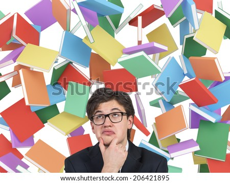 Thinking Businessman And different Books Falling From The Sky, Isolated On White