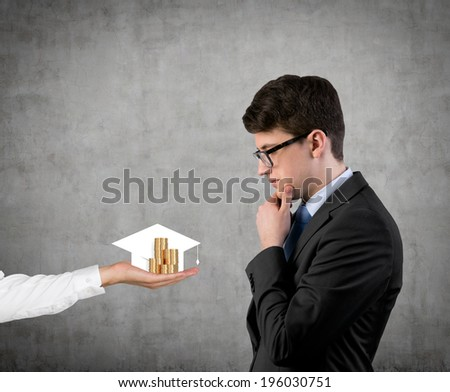 Thinking businessman, graduation hat and coins - stock photo