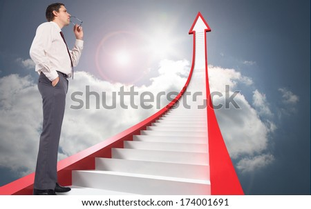 Thinking businessman holding glasses against red stairs arrow pointing up against sky - stock photo