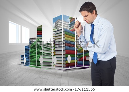 Thinking businessman holding pen against bright room with opened windows