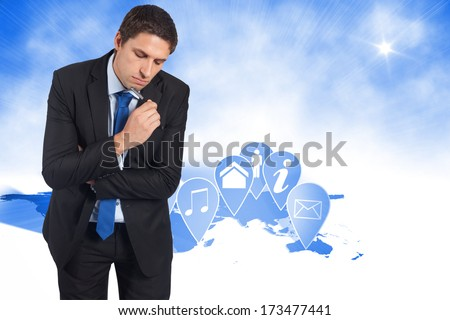 Thinking businessman holding pen against futuristic technology interface
