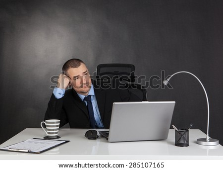 Thinking businessman in office. No idea - stock photo