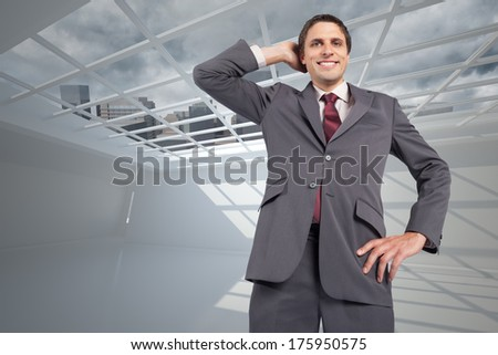 Thinking businessman scratching head against cityscape seen through window