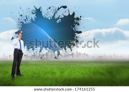 Thinking businessman touching chin against linear graphic above large city