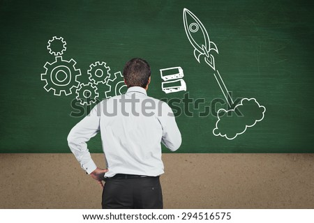Thinking businessman touching his chin against green room - stock photo