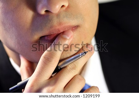 Thinking businessman, trying to make a decision - stock photo