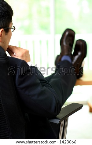 Thinking businessman trying to make a decision - stock photo