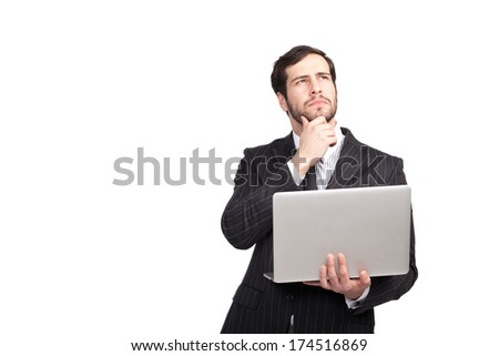 thinking businessman with a laptop in his hand, isolated - stock photo