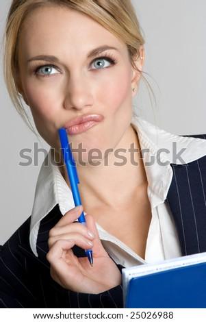 Thinking Businesswoman - stock photo