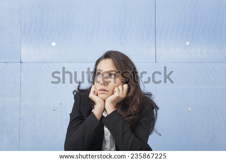 Thinking. businesswoman solving a problem - stock photo