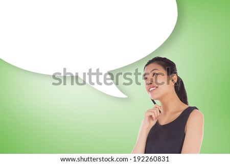 Thinking businesswoman with speech bubble against green vignette