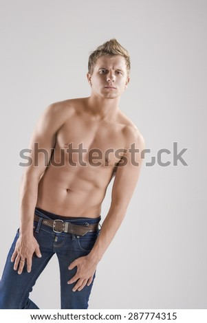 Thinking Caucasian Man with Naked and Tanned Torso. Vertical Image - stock photo