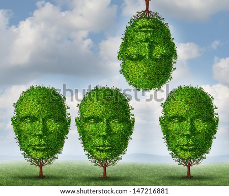 Thinking different creativity concept with a group of trees shaped as a human head with one tree upside down as a symbol freedom and of out of the box creative solutions on a summer sky background. - stock photo