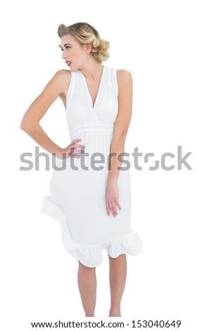 Thinking fashion blonde model posing looking away on white background - stock photo
