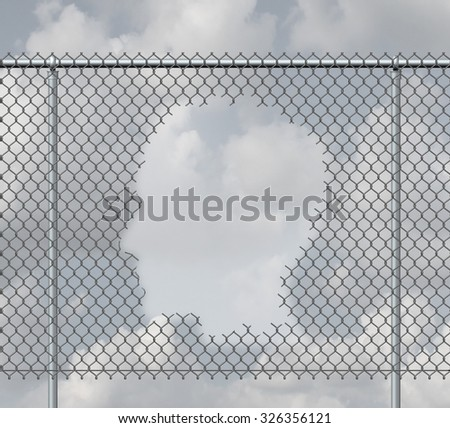 Thinking freedom and personal escape concept as a chain link fence with a hole shaped as a human head as motivation symbol or open mind psychological success metaphor. - stock photo