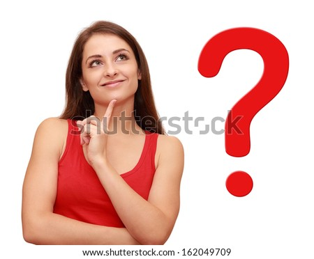 Thinking girl looking up with red question sign near her - stock photo