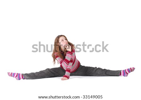 thinking girl sitting in stretching on white - stock photo