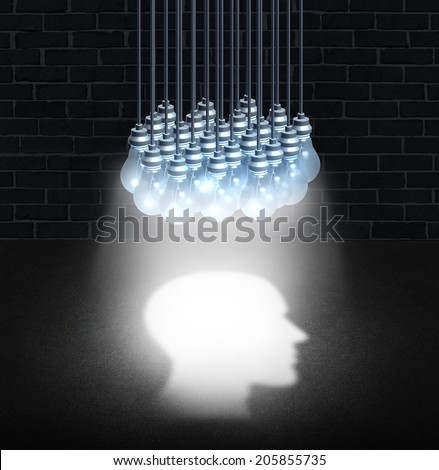 Thinking group and team work creativity concept as a bunch of light bulbs working together shinning down light shaped as a human head for a symbol of creative cooperation or mental health function. - stock photo