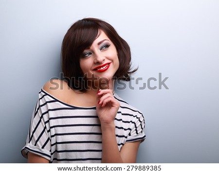Thinking happy young woman looking on copy space. Closeup portrait - stock photo