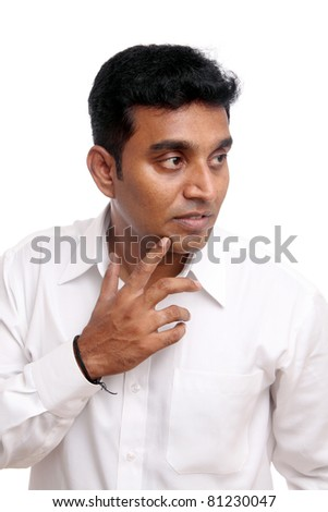 Thinking Indian young businessman, isolated on white.