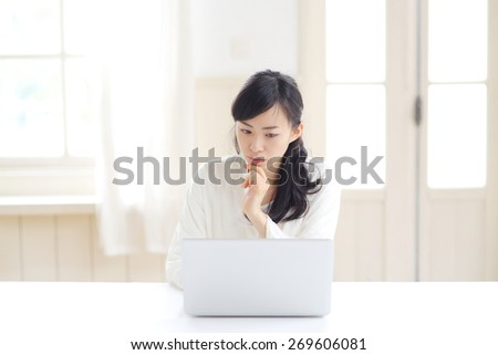 thinking Japanese woman with PC