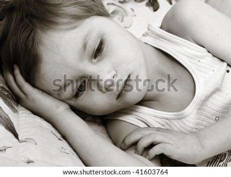 Thinking little boy - stock photo