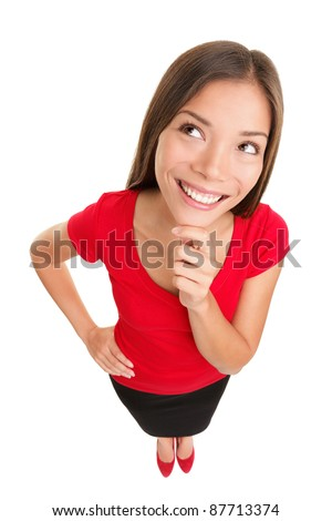 Thinking looking woman in red. Funny high perspective image of contemplating pensive smiling and happy mixed race Caucasian / Asian woman isolated on white background. - stock photo