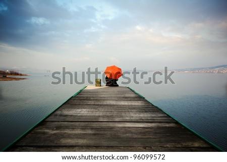 thinking man and sea - stock photo