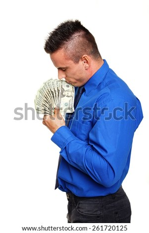 Thinking man in blue shirt with money in hand - stock photo