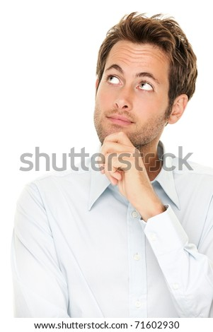 Thinking man isolated on white background. Closeup portrait of a casual young pensive businessman looking up at copyspace. Caucasian male model.