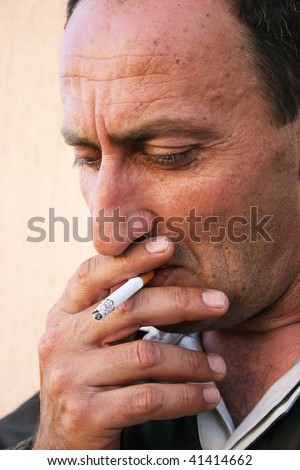 Thinking man smoke the cigarette. - stock photo