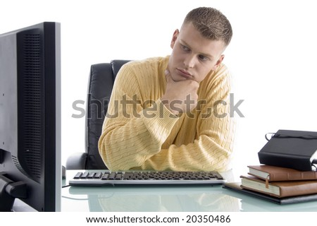 thinking man while looking on screen on an isolated background - stock photo