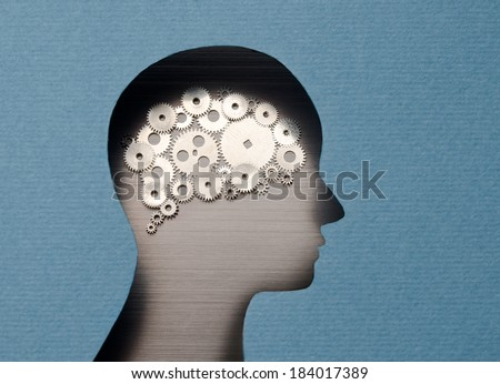 Thinking Mechanism. Human head with brain shaped with gears - stock photo