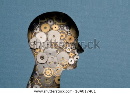Thinking Mechanism. Human head with gears inside - stock photo