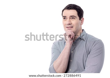 Thinking middle aged man with hand on chin - stock photo