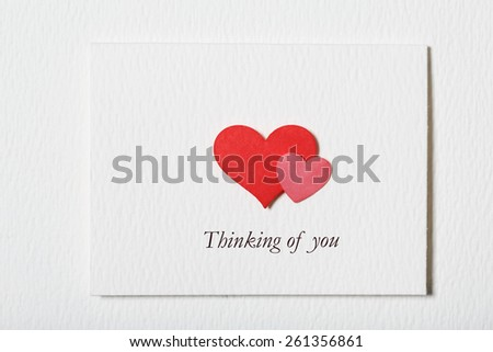Thinking of You white message card with hand made hearts - stock photo