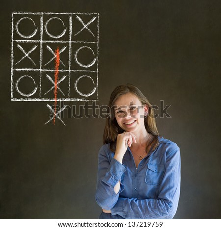 Thinking out of the box businesswoman, student or teacher tic tac toe on blackboard background - stock photo