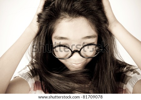 Thinking over, Asian girl shake her dizzy head thinking too much. - stock photo