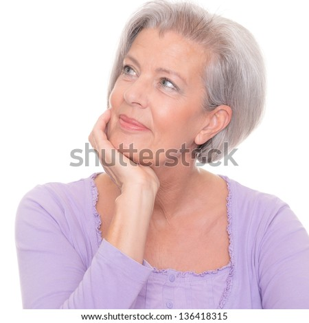 Thinking senior woman in front of white background - stock photo