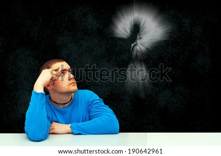 thinking symbol of young man - stock photo
