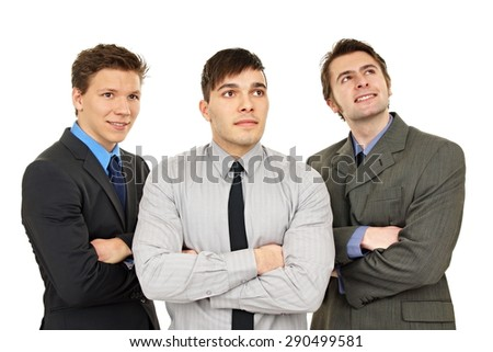 Thinking three business young people watching something