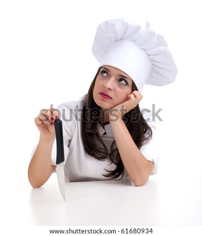 thinking woman chef in white uniform and hat keeping knife